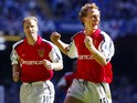 Arsenal's Dennis Bergkamp and Ray Parlour celebrate after Parlour scored the opening goal during the The F.A Cup final against Chelsea at The Millenium Stadium in Cardiff 04 May 2002