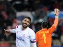 Sevilla's midfielder Vicente Iborra celebrates after scoring during the Europa League football match FC Sevilla vs Villarreal CF at the Ramon Sanchez Pizjuan stadium in Sevilla on March 19, 2015