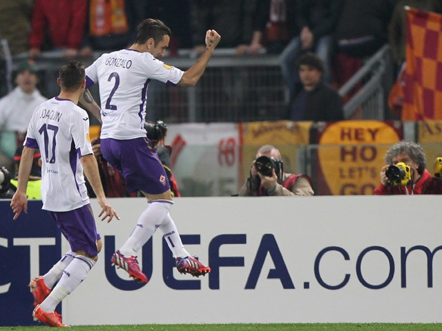 Gonzalo Rodriguez #2 of ACF Fiorentina celebrates after scoring the opening goal from penalty spot during the UEFA Europa League Round of 16 match between AS Roma and ACF Fiorentina at Olimpico Stadium on March 19, 2015