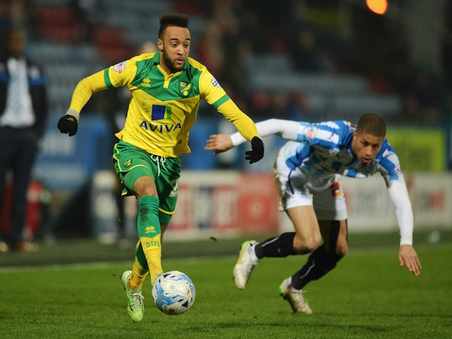Nathan Redmond of Norwich City takes on Jake Carroll of Huddersfield Town during the Sky Bet Championship match on March 17, 2015