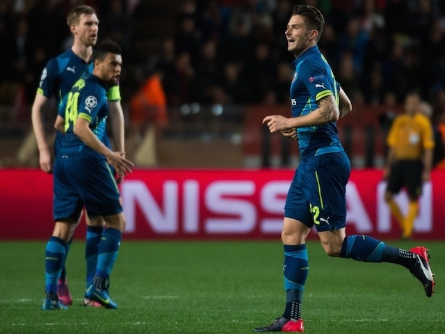 Arsenal's French striker Olivier Giroud celebrates after scoring a goal during the UEFA Champions League football match Monaco vs Arsenal, on March 17, 2015