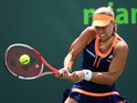 Angelique Kerber of Germany plays a backhand against Heather Watson of Great Britain in their second round match during the Miami Open Presented by Itau at Crandon Park Tennis Center on March 28, 2015