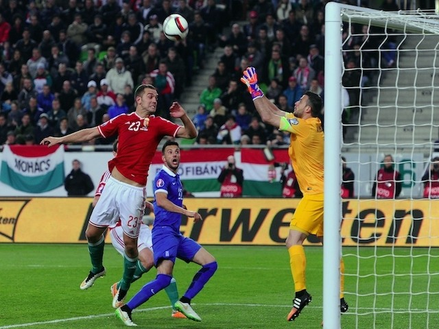 Greece's goalkeeper Orestis Karnezis (R) and midfielder Andreas Samaris (C) vie with Hungary's defender Roland Juhasz during the Euro 2016 qualifying football match between Hungary and Greece at the Groupama Arena in Budapest on March 29, 2015