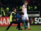 A security official detains a man on the field in front of Germany's midfielder Andre Schurrle after the Euro 2016 qualifying football match between Georgia and Germany at the Boris-Paitschadse-Stadium in Tbilisi , Georgia on March 29, 2015