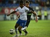 Portugal's defender Cedric Soares (R) vies with Cape Verde's forward Heldon (L) during the EURO 2016 friendly football match Portugal vs Cape Verde at the Antonio Coimbra da Mota stadium in Estoril outside Lisbon on March 31, 2015