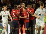 Lille's belgian forward Divock Origi is congratulated by teammates after scoring a goal during the French Ligue football match Lille vs Reims on April 4, 2015