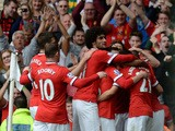 Manchester United players congratulate Manchester United's Spanish midfielder Ander Herrera