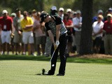 Rory McIlroy of Northern Ireland hits a shot at the 1st hole during the final round of the Masters golf tournament at Augusta National Golf Club on April 10, 2011