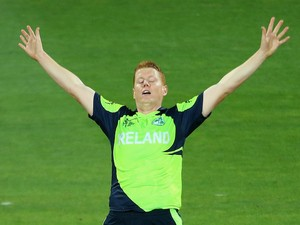 Kevin O'Brien of Ireland celebrates getting the wicket of Sean Williams of Zimbabwe during the 2015 ICC Cricket World Cup match between Zimbabwe and Ireland at Bellerive Oval on March 7, 2015