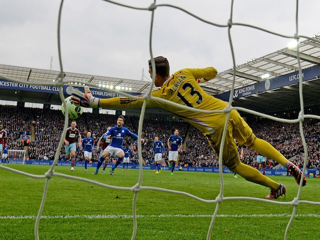 Adrian the Whest Ham United goalkeeper saves the penalty taken by David Nugent during the Barclays Premier League match between Leicester City and West Ham United at The King Power Stadium on April 4, 2015
