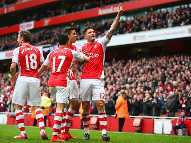 Olivier Giroud of Arsenal celebrates with team mates after scoring his team's fourth goal during the Barclays Premier League match between Arsenal and Liverpool at Emirates Stadium on April 4, 2015
