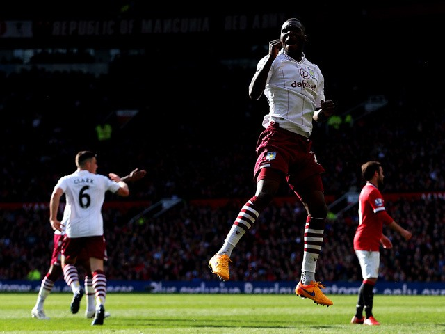 Christian Benteke of Aston Villa celebrates after scoring his team's first goal during the Barclays Premier League match between Manchester United and Aston Villa at Old Trafford on April 4, 2015