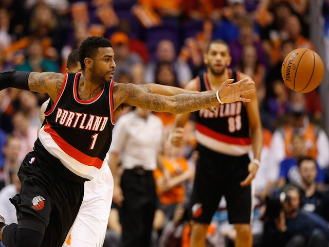 Dorell Wright #1 of the Portland Trail Blazers reaches for a loose ball during the first half of the NBA game against the Phoenix Suns at US Airways Center on January 21, 2015