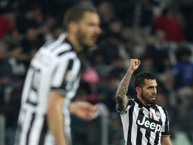 Juventus' Argentinian forward Alberto Carlos Tevez celebrates after scoring during the Italian Serie A football match Juventus Vs Empoli on April 4, 2015