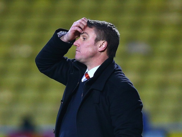 Blackpool manager Lee Clark looks dejected during the Sky Bet Championship match against Watford at Vicarage Road on January 24, 2015