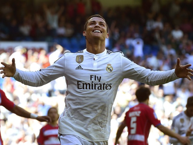 Real Madrid's Portuguese forward Cristiano Ronaldo celebrates a goal during the Spanish league football match Real Madrid CF vs Granada FC at the Santiago Bernabeu stadium in Madrid on April 5, 2015