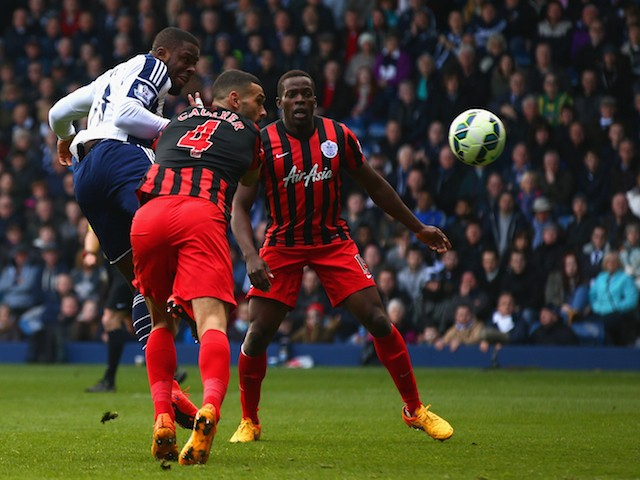 Victor Anichebe of West Brom scores their first goal during the Barclays Premier league match West Bromwich Albion and Queens Park Rangers at The Hawthorns on April 4, 2015