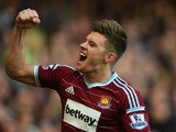 Aaron Cresswell of West Ham celebrates scoring the first goal during the Barclays Premier League match between West Ham United and Stoke City at Boleyn Ground on April 11, 2015