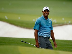 Tiger Woods of the United States smiles on the practice range during a practice round prior to the start of the 2015 Masters Tournament at Augusta National Golf Club on April 6, 2015