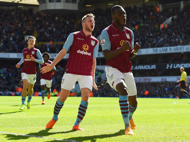 Christian Benteke of Aston Villa celebrates scoring their first goal with Tom Cleverley of Aston Villa during the Barclays Premier League match between Tottenham Hotspur and Aston Villa at White Hart Lane on April 11, 2015