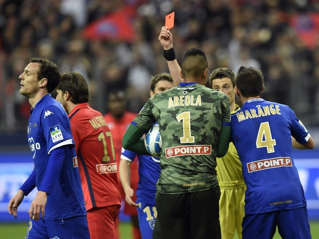 French referee Benoît Bastien gives a red card to Bastia's French defender Sebastien Squillaci during the French League Cup final football match Bastia (SCB) vs Paris Saint-Germain, on April 11, 2015