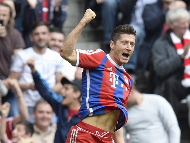 Bayern Munich's Polish striker Robert Lewandowski celebrates after the first goal during the German first division Bundesliga football match between FC Bayern Muenchen vs Eintracht Frankfurt in Munich, Germany, on April 11, 2015