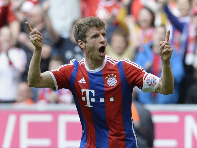 Bayern Munich's striker Thomas Muller celebrates after the third goal for Munich during the German first division Bundesliga football match between FC Bayern Munchen vs Eintracht Frankfurt in Munich, Germany, on April 11, 2015