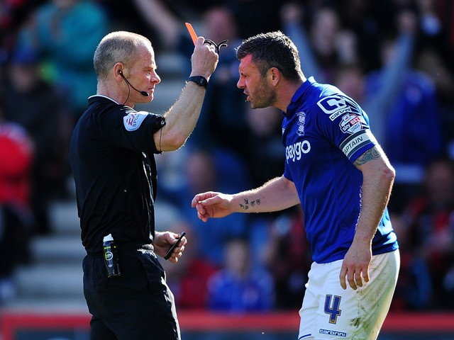 Referee, Andy Woolmer shows a red card to Paul Robinson of Birmingham City during the Sky Bet Championship match between AFC Bournemouth and Birmingham City at Goldsands Stadium on April 6, 2015