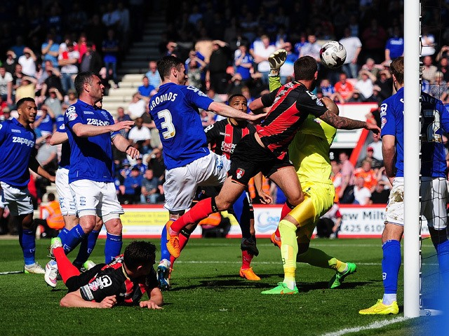 Steve Cook of AFC Bournemouth scores his side's first goal during the Sky Bet Championship match between AFC Bournemouth and Birmingham City at Goldsands Stadium on April 6, 2015