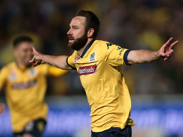 Josh Rose of the Mariners celebrates a goal during the round 25 A-League match between the Central Coast Mariners and the Western Sydney Wanderers at Central Coast Stadium on April 11, 2015