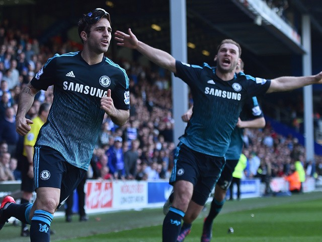 Chelsea's Spanish midfielder Cesc Fabregas celebrates with Chelsea's Serbian defender Branislav Ivanovic after scoring their goal during the English Premier League football match between Queens Park Rangers and Chelsea at Loftus Road Stadium in London on