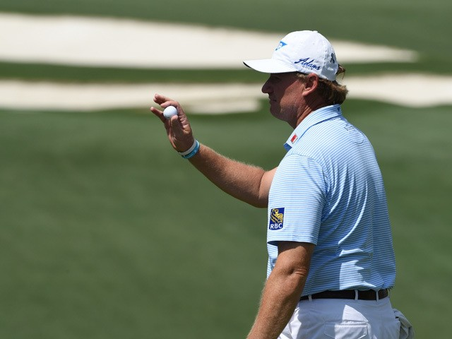 Ernie Els of South Africa greets fans on the 10th hole during Round 1 of the 79th Masters Golf Tournament at Augusta National Golf Club on April 9, 2015