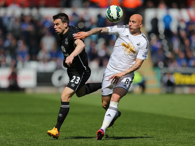 Seamus Coleman of Everton and Jonjo Shelvey of Swansea battle for the ball during the Barclays Premier League match between Swansea City and Everton at Liberty Stadium on April 11, 2015