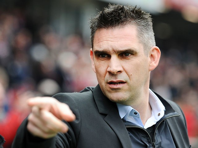 Guingamp's French head coach Jocelyn Gourvennec gestures during the French L1 football match between Guingamp and Lyon on April 4, 2015