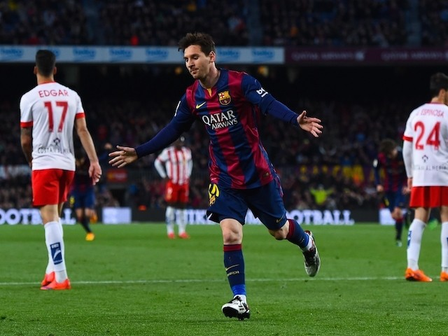Lionel Messi of FC Barcelona celebrates after scoring the opening goal during the La Liga match between FC Barcelona and UD Almeria at Camp Nou on April 8, 2015