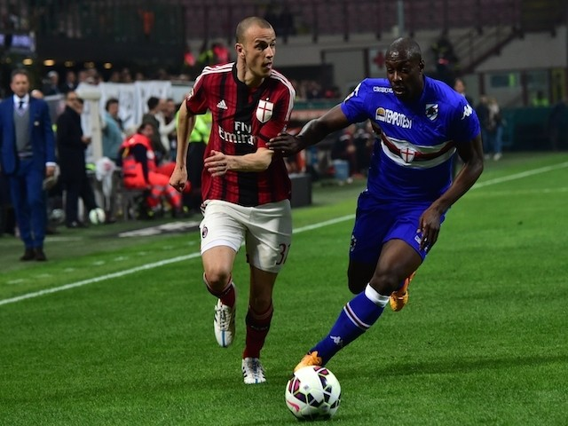 AC Milan's defender Luca Antonelli (L) fights for the ball with Sampdoria's forward Stefano Okaka during the Italian Serie A football match between AC Milan and Sampdoria at San Siro Stadium in Milan on April 12, 2015