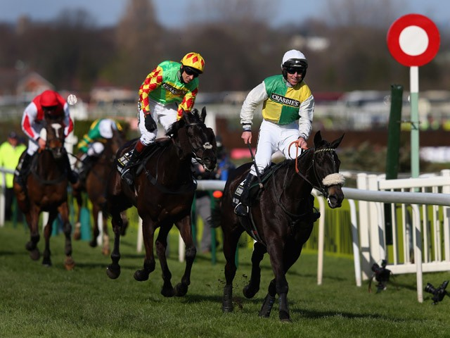 Many Clouds ridden by Leighton Aspell wins the 2015 Crabbie's Grand National at Aintree Racecourse on April 11, 2015