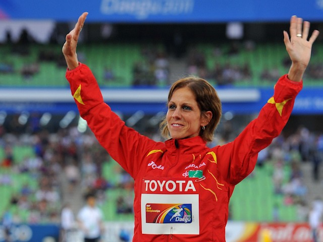 Bronze medallist Natalia Rodriguez of Spain waves to the crowd during the award ceremony for the women's 1500 metres hurdles event at the International Association of Athletics Federations (IAAF) World Championships in Daegu on September 2, 2011