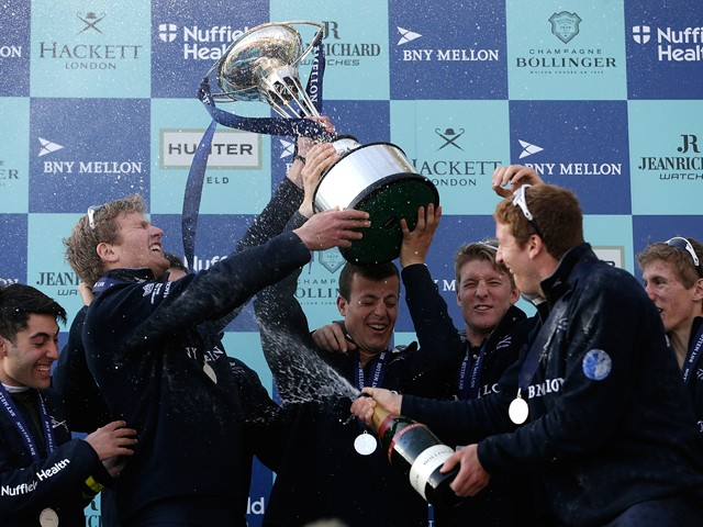 Oxford celebrates with the trophy during the BNY Mellon University Boat Race 2015 between Oxford and Cambridge on April 11, 2015