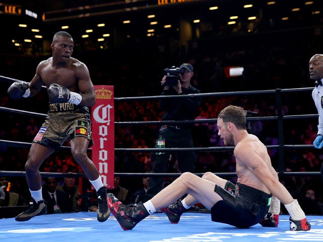 Peter Quillin knocks down Andy Lee during the Premier Boxing Champions Middleweight bout at Barclays Center on April 11, 2015