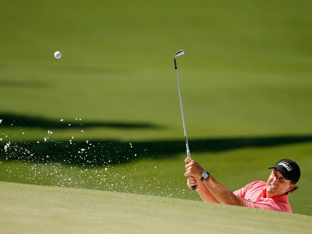 Phil Mickelson of the United States plays a bunker shot on the seventh hole during the third round of the 2015 Masters Tournament at Augusta National Golf Club on April 11, 2015