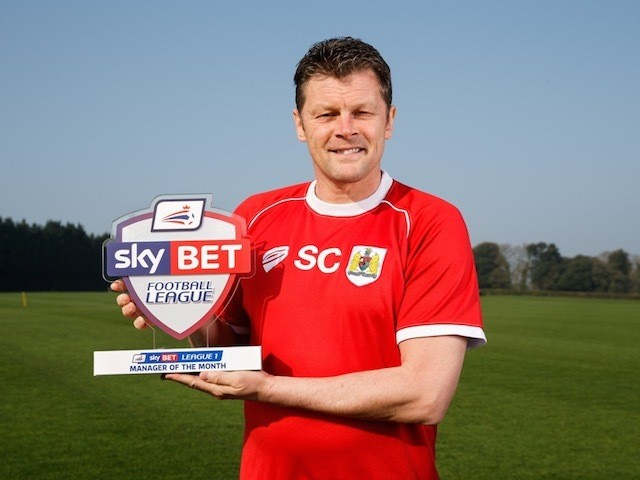 Bristol City boss Steve Cotterill poses with his Manager of the Month award for March 2015