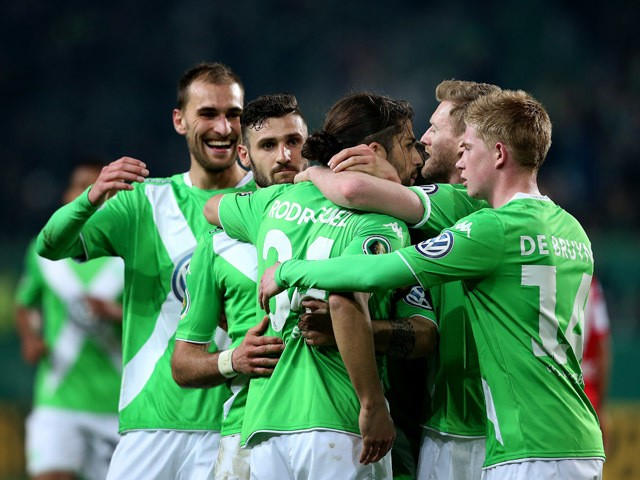 Wolfsburg's Swiss defender Ricardo Rodriguez celebrates after scoring  during the German Football Cup DFB Pokal quarter-final football match between VfL Wolfsburg and SC Freiburg in Wofsburg, central Germany, on April 7, 2015