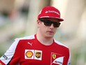 Kimi Raikkonen of Finland and Ferrari walks across the paddock during practice for the Bahrain Formula One Grand Prix at Bahrain International Circuit on April 17, 2015
