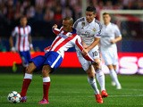 Miranda of Atletico Madrid and James Rodriguez of Real Madrid CF battle for the ball during the UEFA Champions League Quarter Final First Leg match between Club Atletico de Madrid and Real Madrid CF at Vicente Calderon Stadium on April 14, 2015