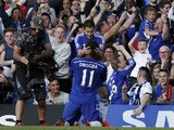 Chelsea's Belgian midfielder Eden Hazard celebrates scoring the opening goal with Chelsea's Ivorian striker Didier Drogba during the English Premier League football match between Chelsea and Manchester United at Stamford Bridge in London on April 18, 2015