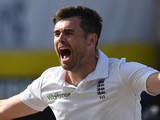 English fast bowler James Anderson celebrates after becoming the highest ever English wicket taker with 384 after taking the wicket of West Indies captain Denesh Ramdin on day five of the first cricket Test match between West Indies and England at the Sir