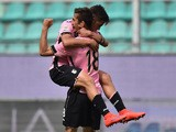Ivaylo Chochev of Palermo celebrates with Paulo Dybala after scoring his second goal during the Serie A match between US Citta di Palermo and Genoa CFC at Stadio Renzo Barbera on April 19, 2015