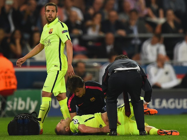 Andres Iniesta of Barcelona lies injured on the pitch during the UEFA Champions League Quarter Final First Leg match between Paris Saint-Germain and FC Barcelona at Parc des Princes on April 15, 2015