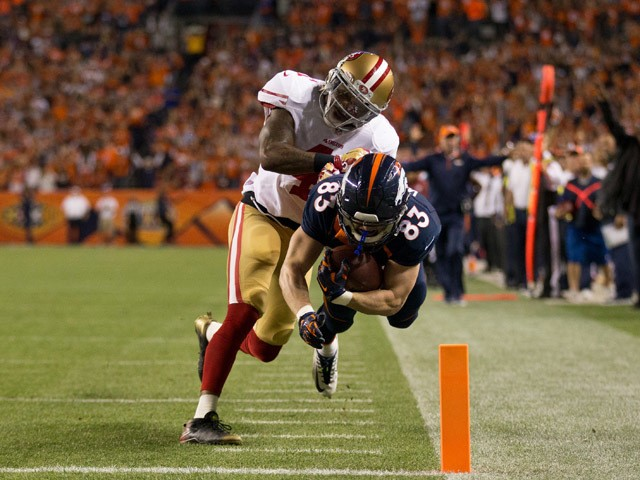 Wide receiver Wes Welker #83 of the Denver Broncos is forced out of bounds at the goal line by strong safety Antoine Bethea #41 of the San Francisco 49ers on a 39 yard touchdown catch at Sports Authority Field at Mile High on October 19, 2014